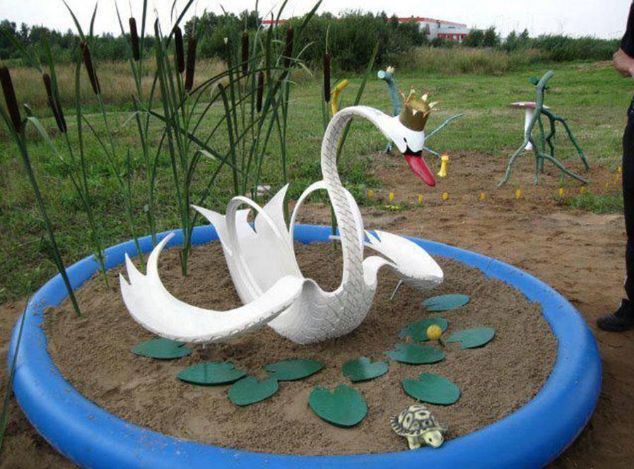 imagenes de arte con llantas o neumaticos aves y figuras a partir de una rueda de automovil